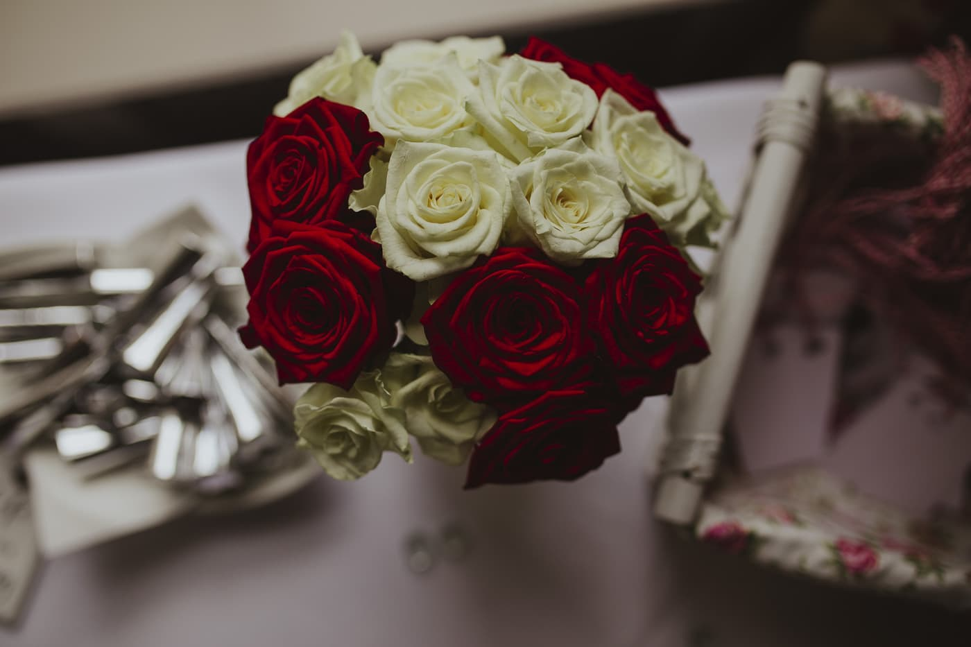 Red and white flowers for wedding by Joshua Wyborn photography