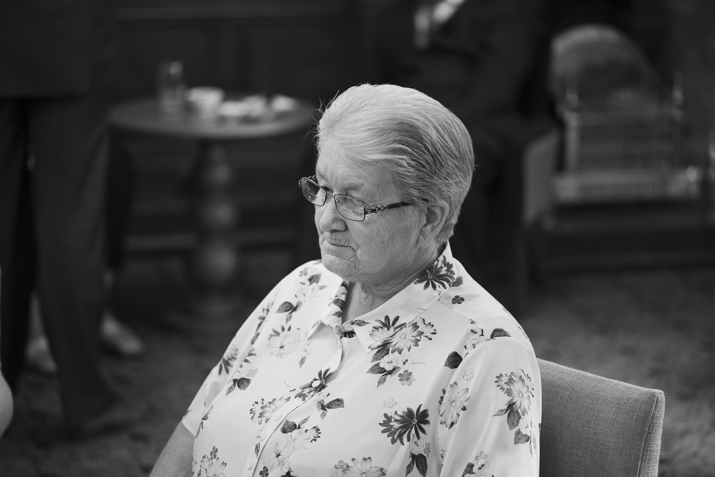 Lady in flowery shirt and glasses for wedding by Joshua Wyborn photography