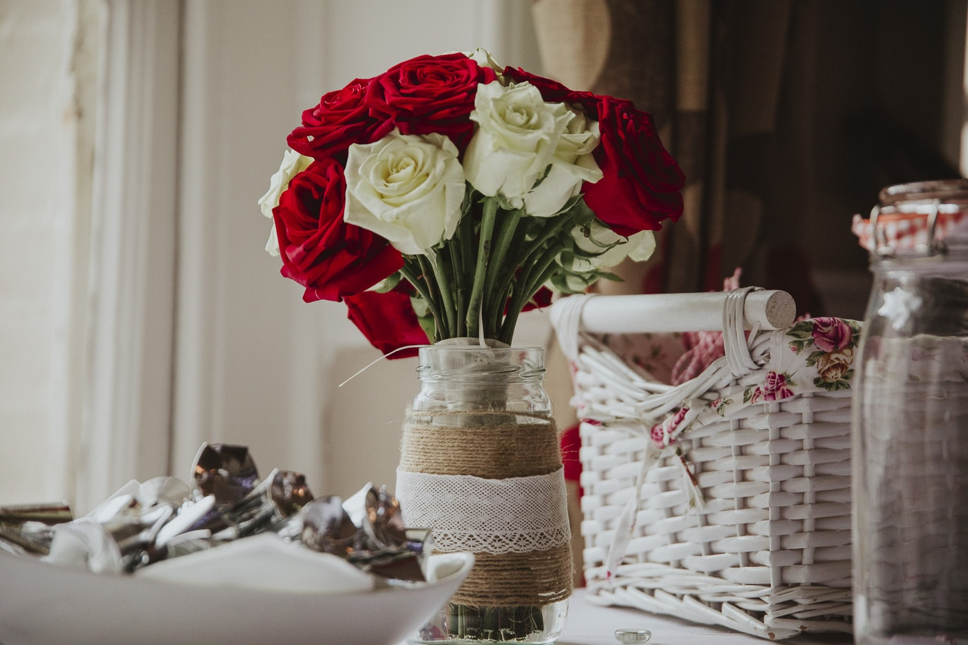 Red and white roses for wedding by Joshua Wyborn photography