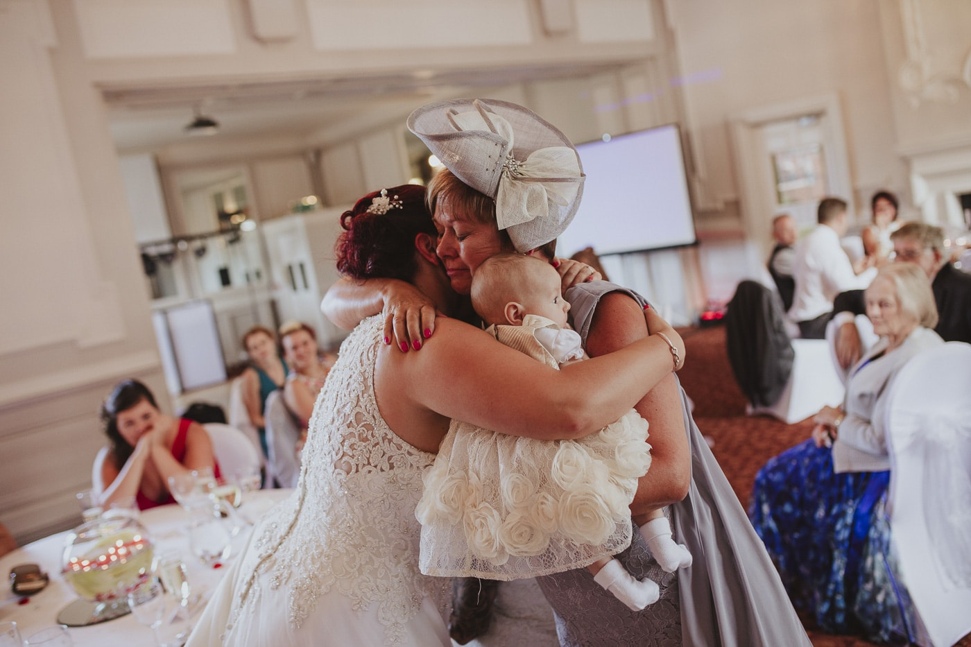 ladies hugging with baby for wedding by Joshua Wyborn photography