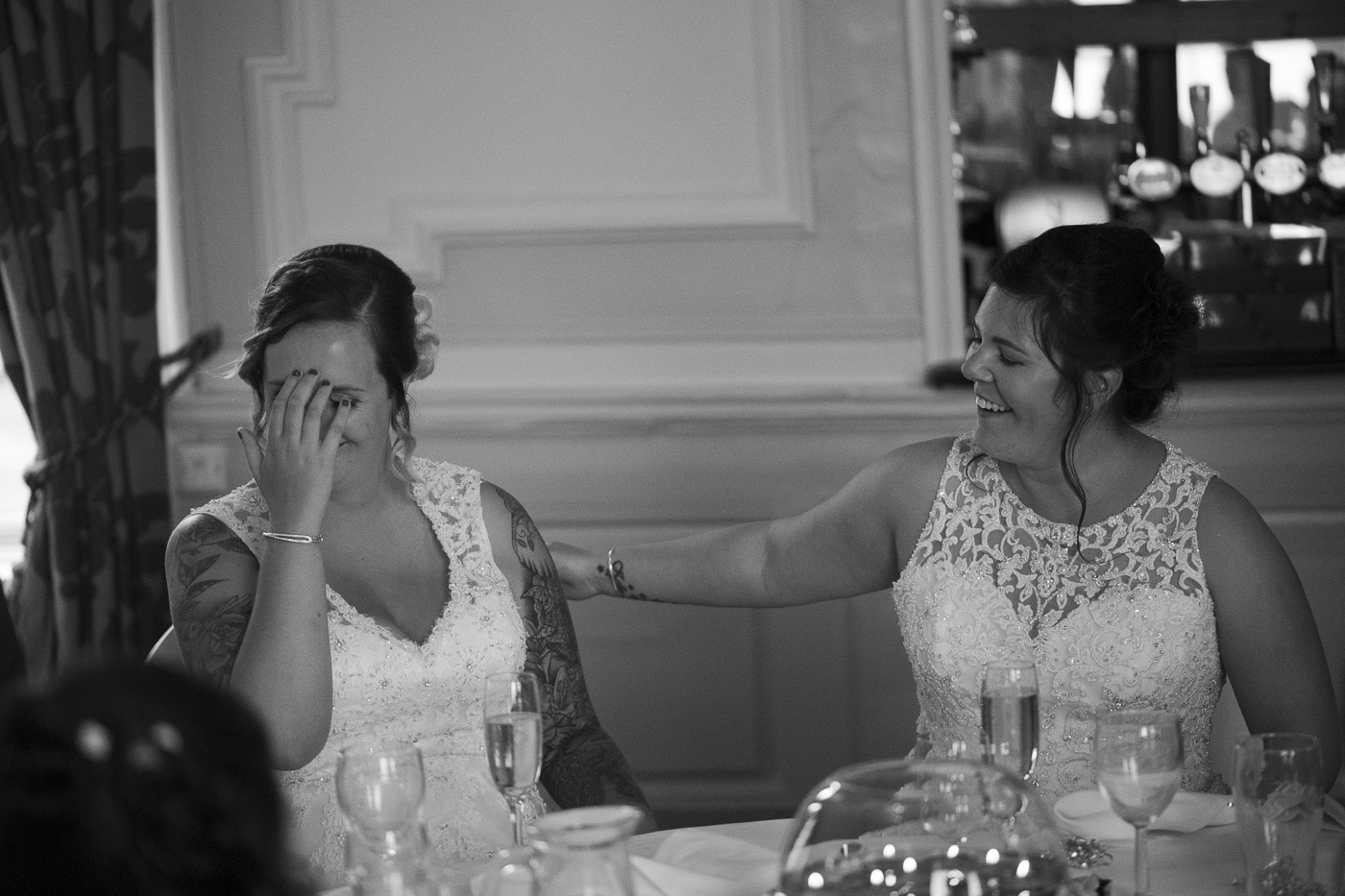 Brides consoling each other for wedding by Joshua Wyborn photography