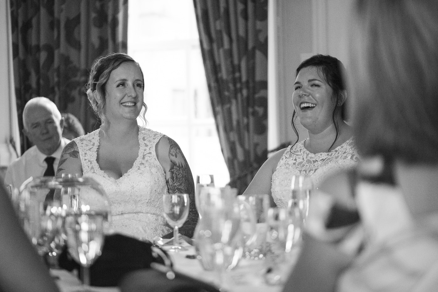 Brides laughing over speeches for wedding by Joshua Wyborn photography