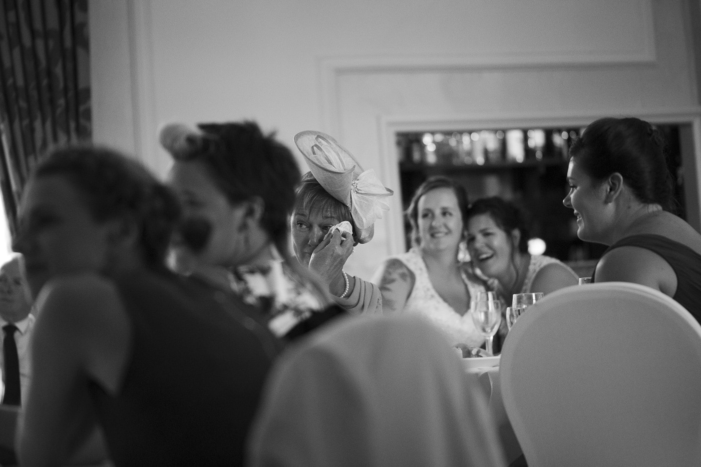 Wiping her eyes during speeches for wedding by Joshua Wyborn photography