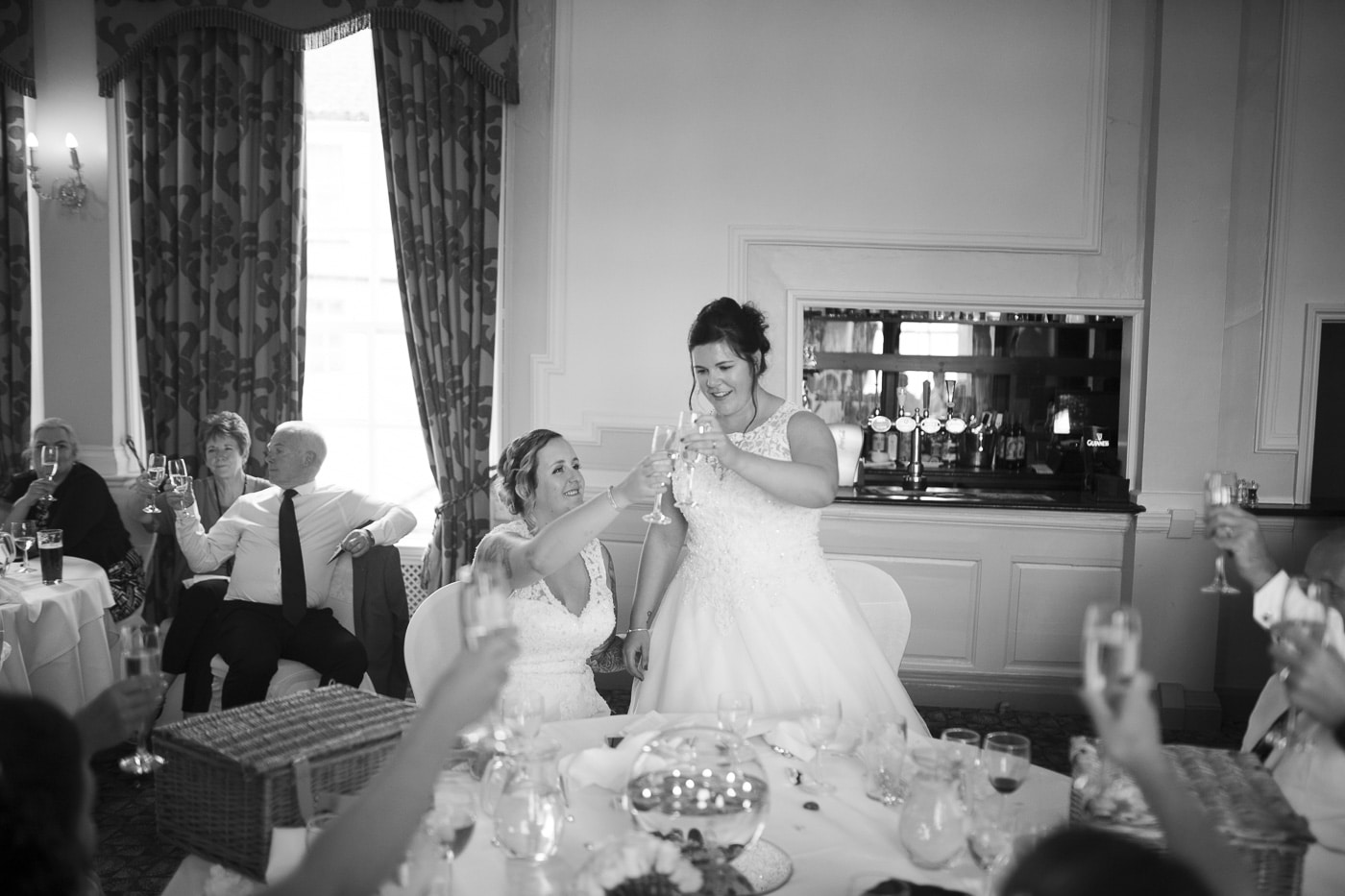 Brides making a toast for wedding photography by Joshua Wyborn