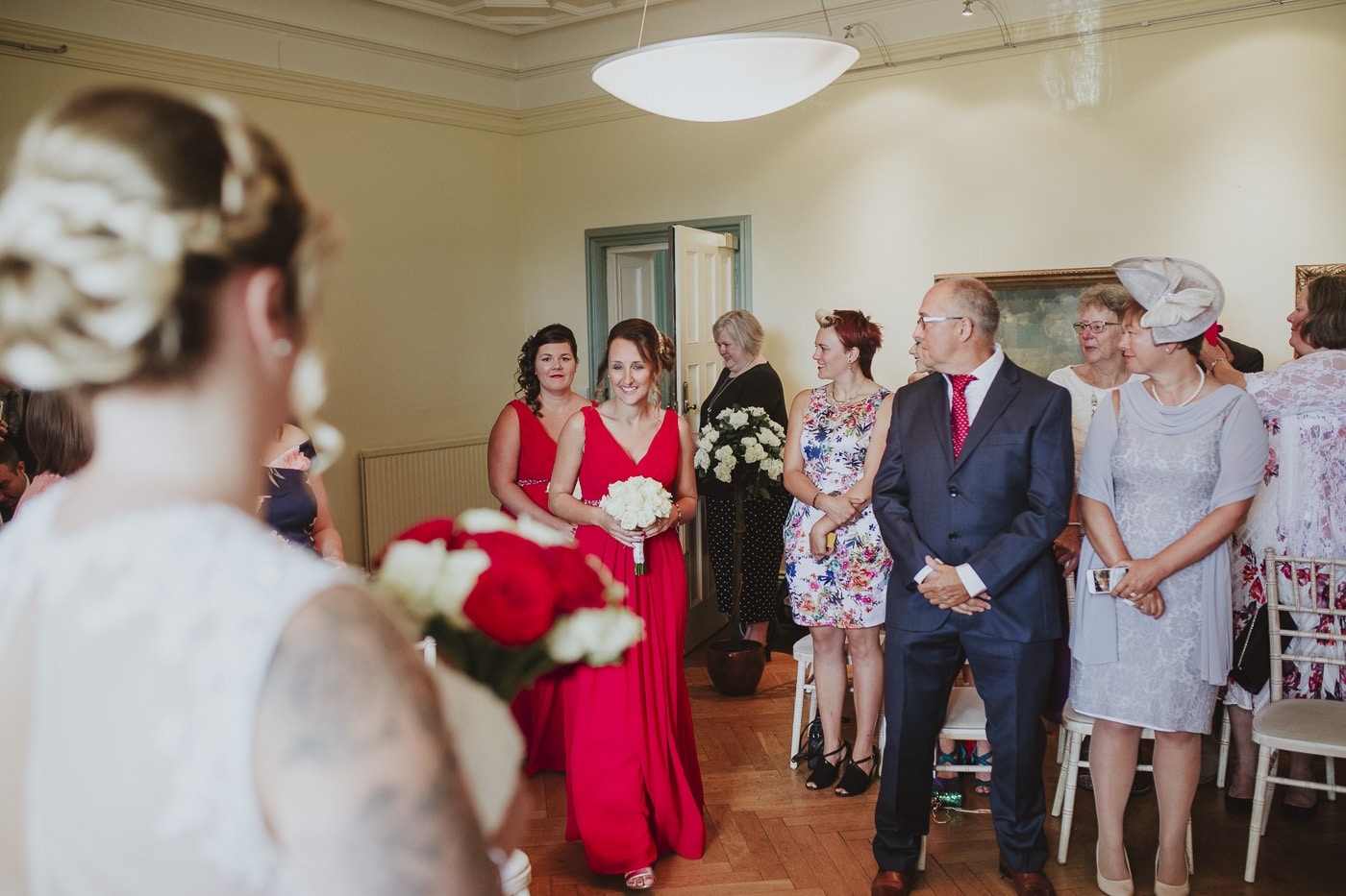 Bridesmaids walk down the aisle for wedding by Joshua Wyborn photography