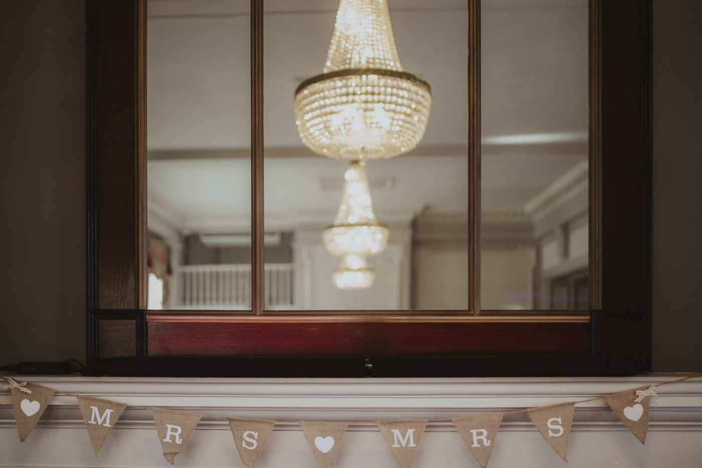 Bunting and light in mirror for wedding photography by Joshua Wyborn
