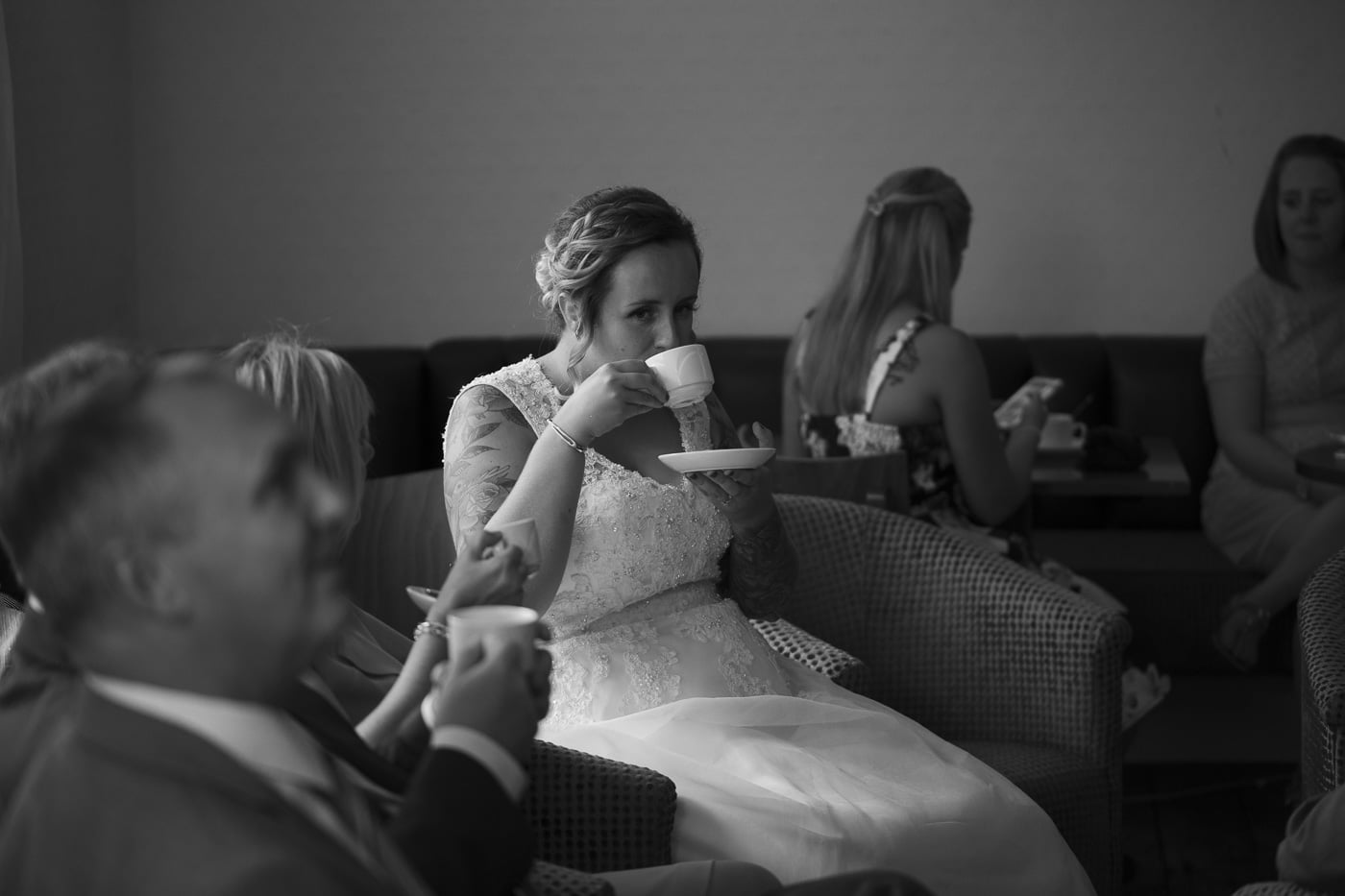 Bride having a cup of tea for wedding photography by Joshua Wyborn