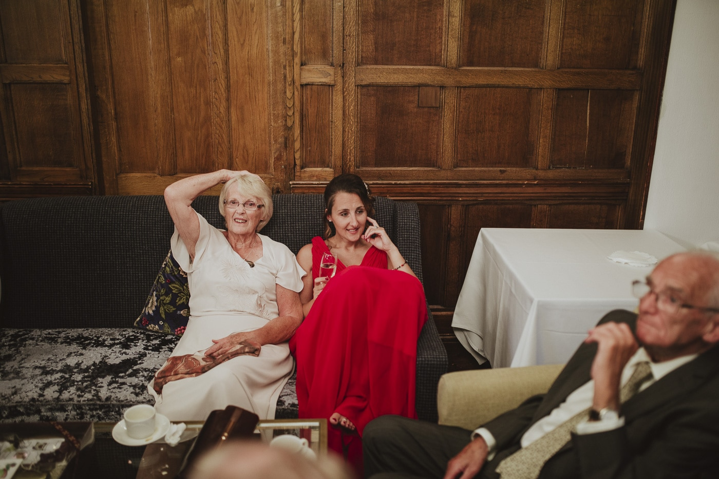 Guests sitting and relaxing for wedding photography by Joshua Wyborn