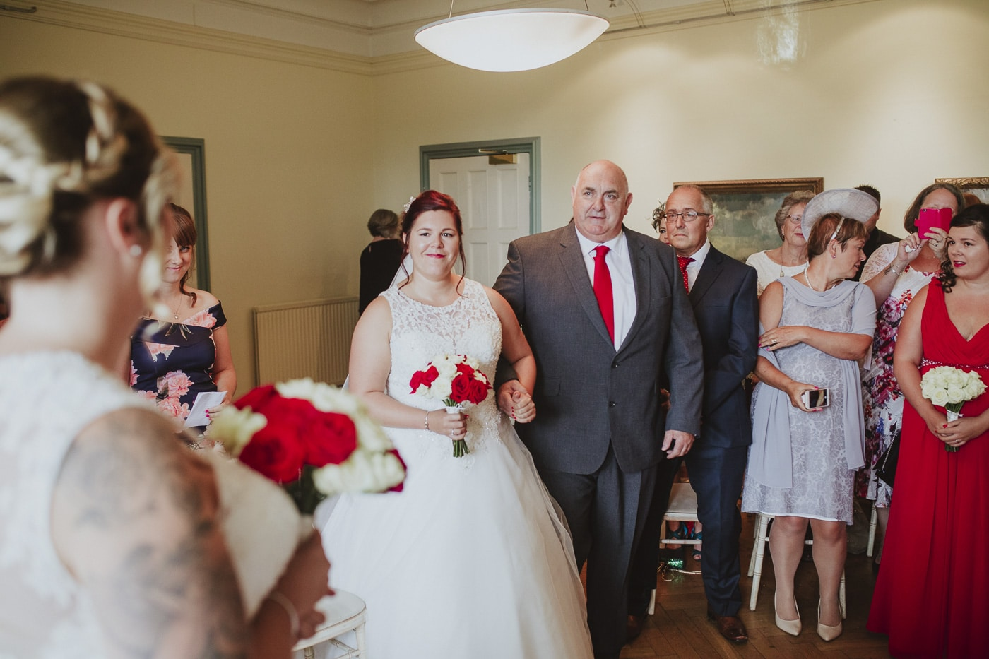 Bride and father walking down the aisle for wedding by Joshua Wyborn photography