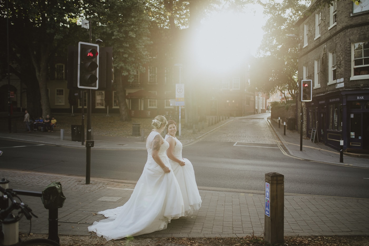 Brides walking down the street for wedding photography by Joshua Wyborn