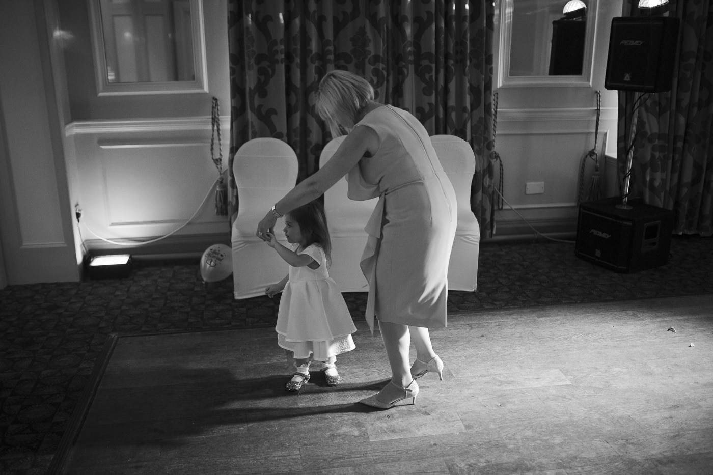 Lady and small girl dancing for wedding photography by Joshua Wyborn