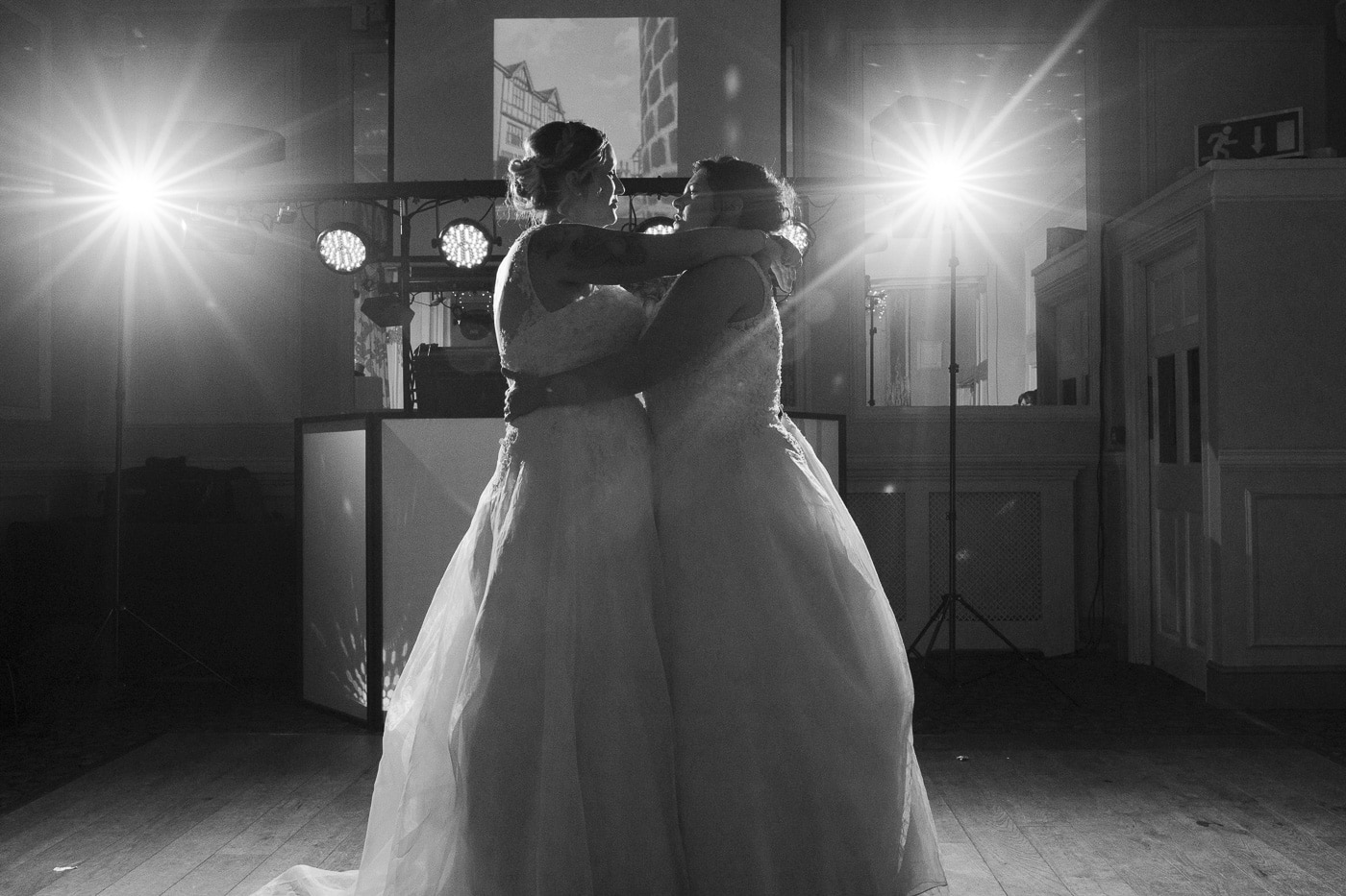 Two brides dancing for wedding photography by Joshua Wyborn
