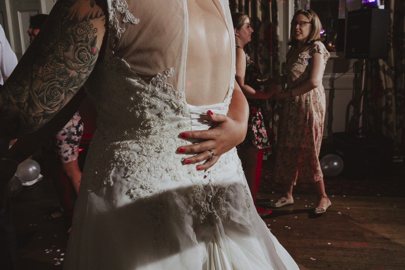 hand on brides back for wedding photography by Joshua Wyborn