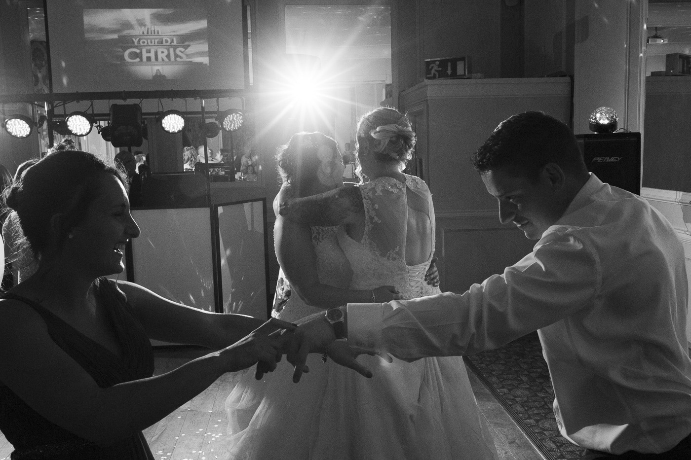 Dancing around the brides on the dancefloor for wedding photography by Joshua Wyborn