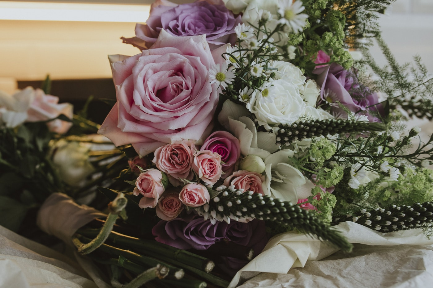 Fresh flower bouquet with pink roses for Cumbria wedding by Joshua Wyborn