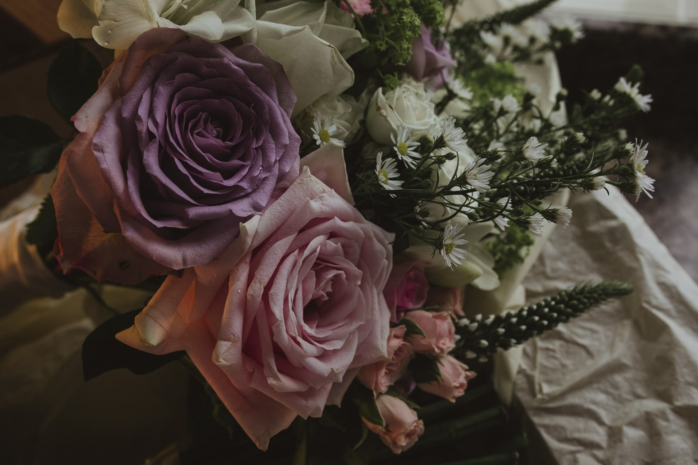 Pink and purple roses with daisies for Cumbria wedding by Joshua Wyborn