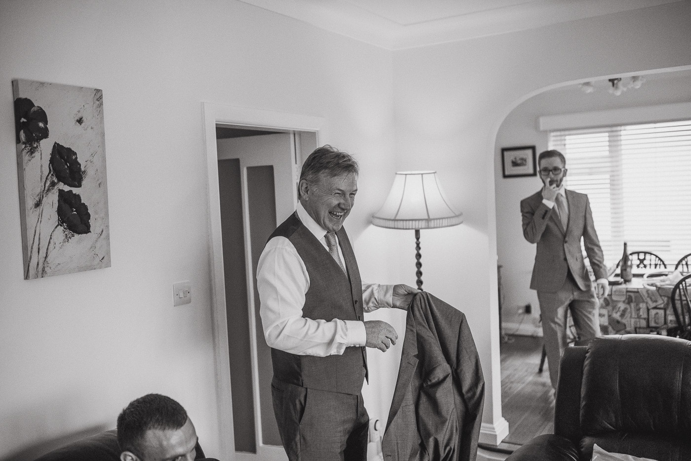 Getting ready and putting on jacketsby Joshua Wyborn wedding photographer