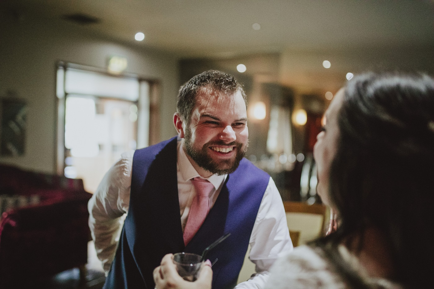 Groom laughing with bride by Joshua Wyborn