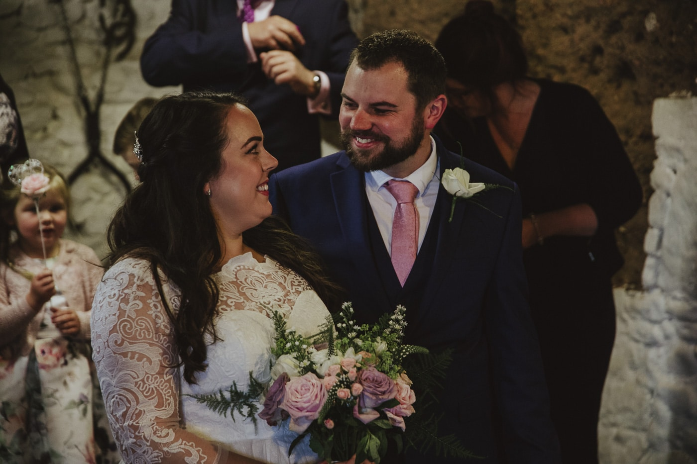 Bride and groom smiling at each other during gretna green wedding