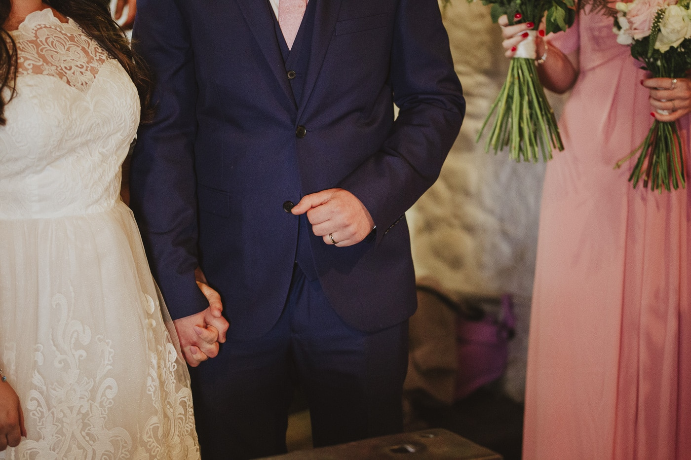 Grooms ring and navy blue suit at wedding in gretna green
