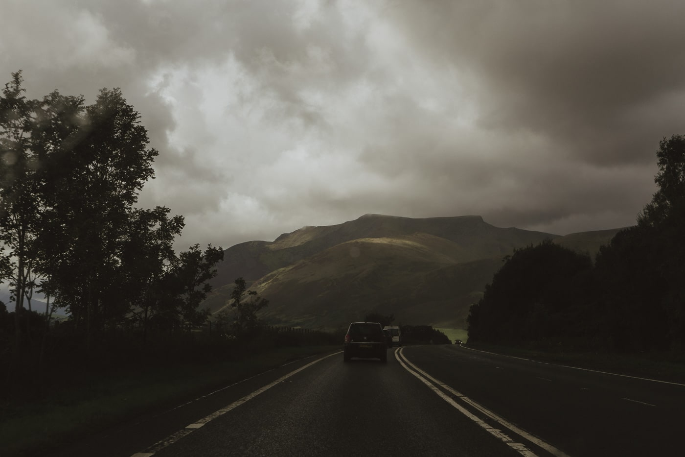 Driving into the mountains and clouds by Joshua Wyborn
