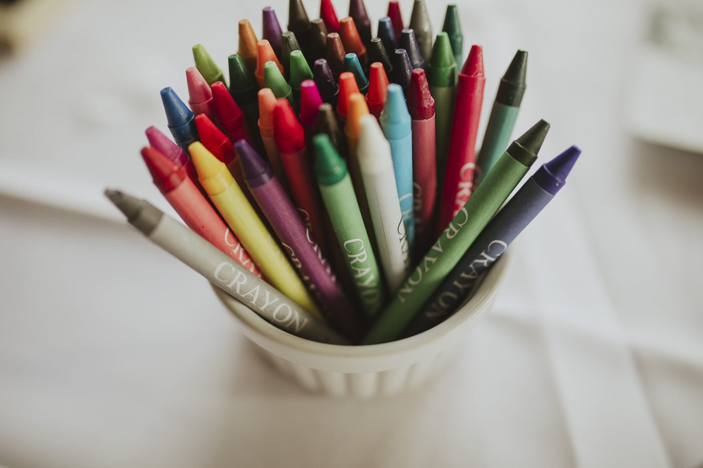 Tub of crayons by Joshua Wyborn