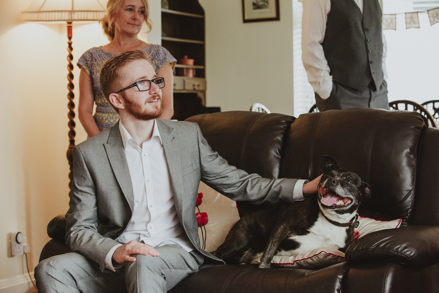 Guest petting dog by Joshua Wyborn Wedding Photographer