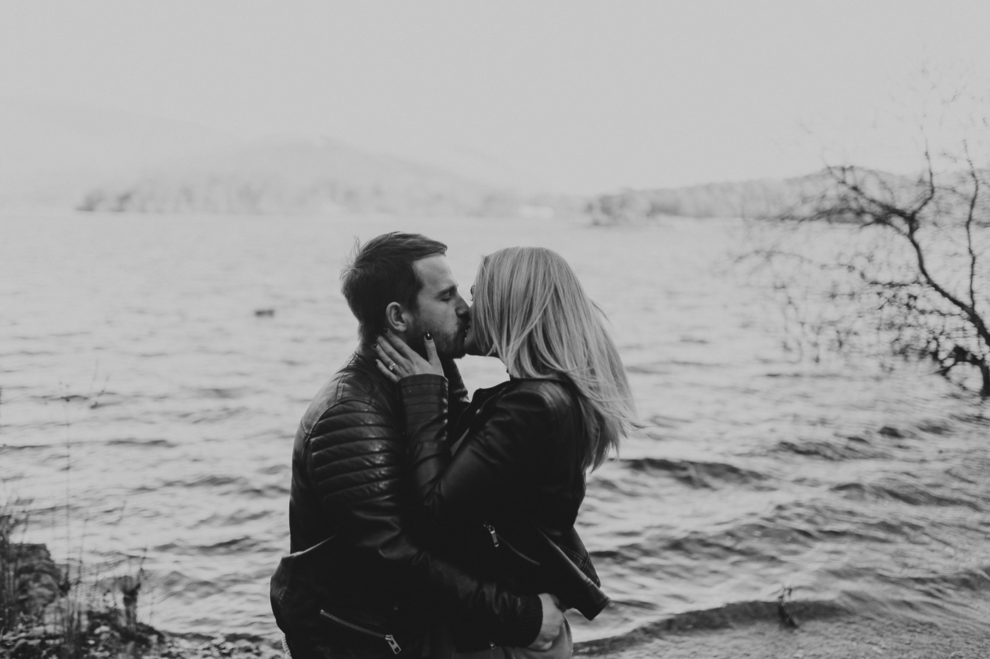 Couple kissing by the lakeshore