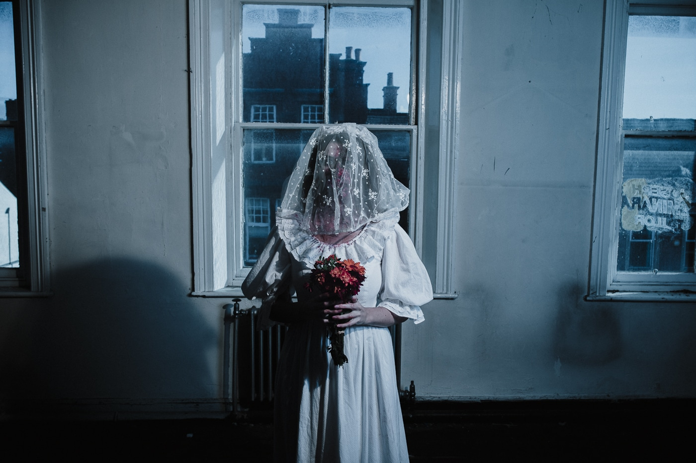 Halloween Horror bride Photograph with veil down over brides face