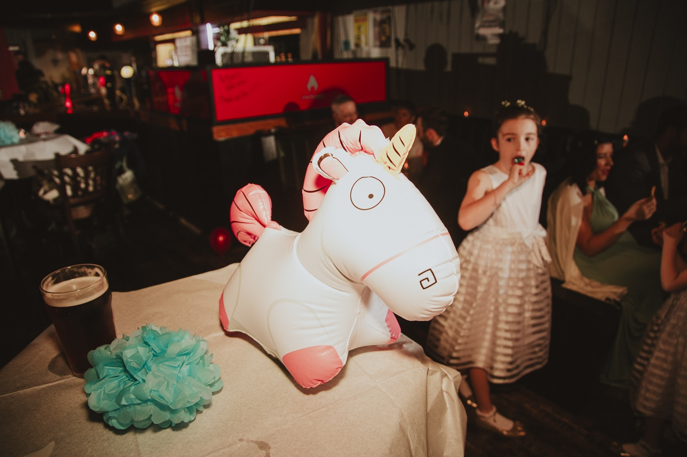 inflatable unicorn with kids by Joshua Wyborn