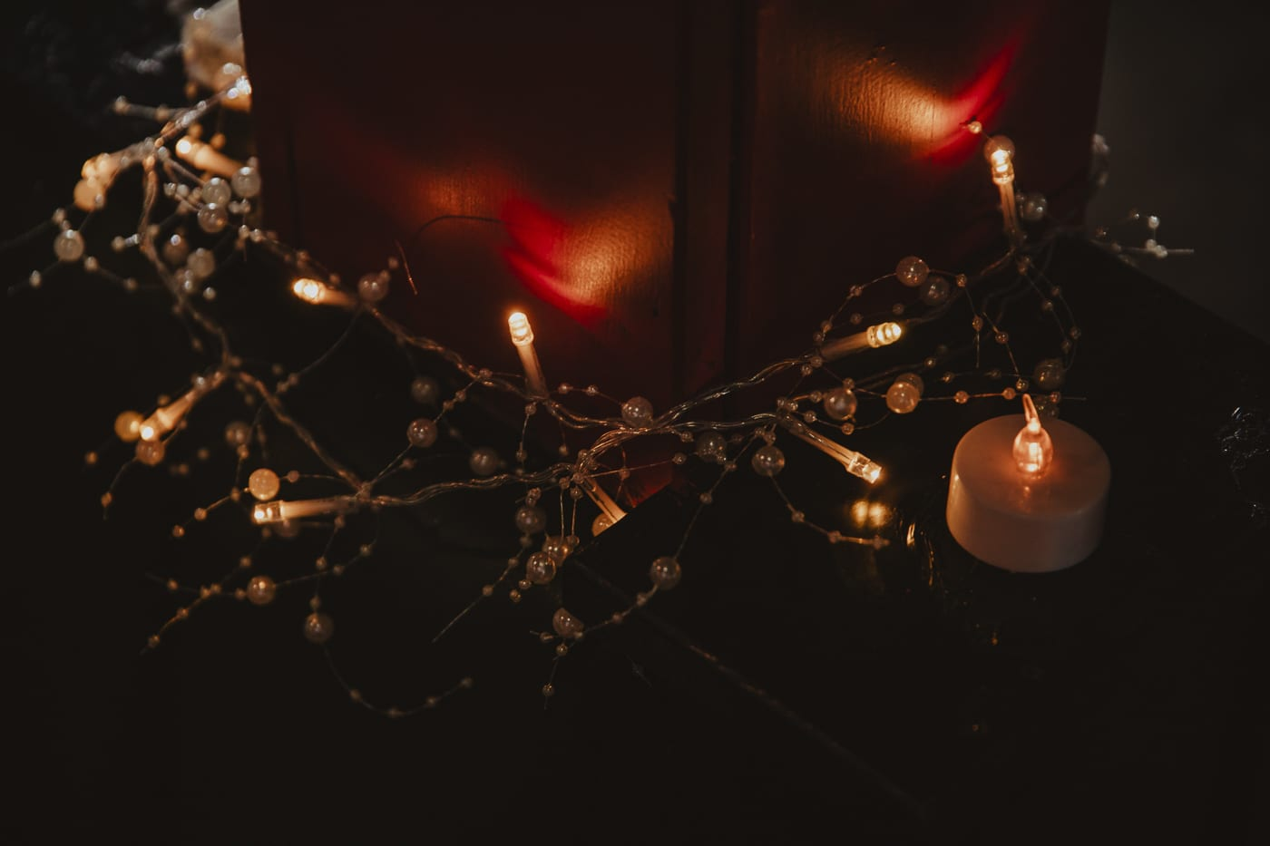 Fairy lights and candles by Joshua Wyborn
