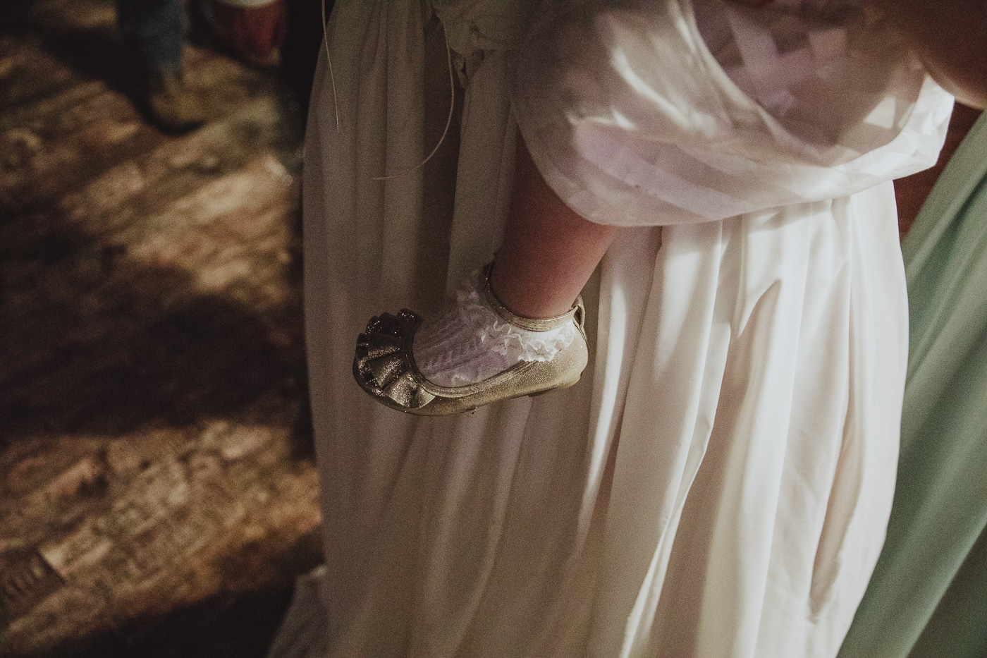 Little girls gold shoes and frilly socks by Joshua Wyborn Photographic