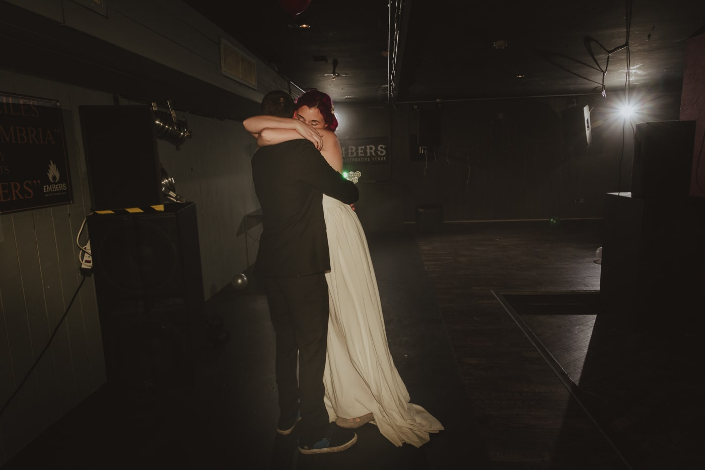 Bride hugging groom on the dancefloor by Joshua Wyborn Photographic