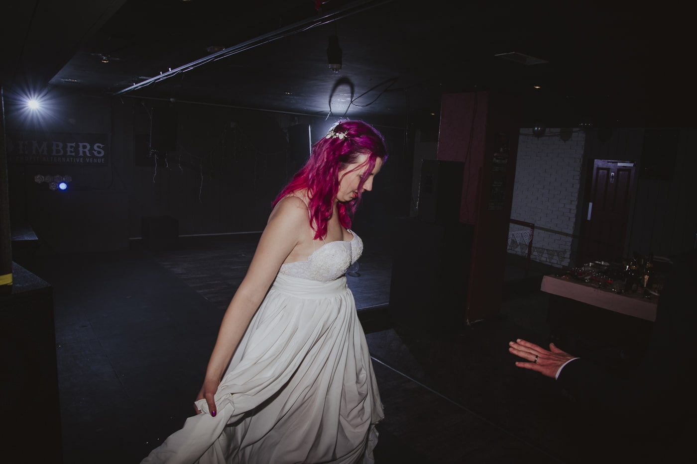 Bride swishing wedding dress by Joshua Wyborn Photographic