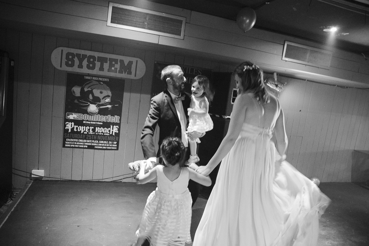 Bride and groom on dancefloor with kids by Joshua Wyborn Photographic