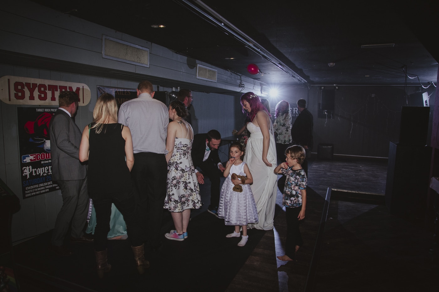 Guests with bride and groom on wedding dancefloor by Joshua Wyborn Photographic
