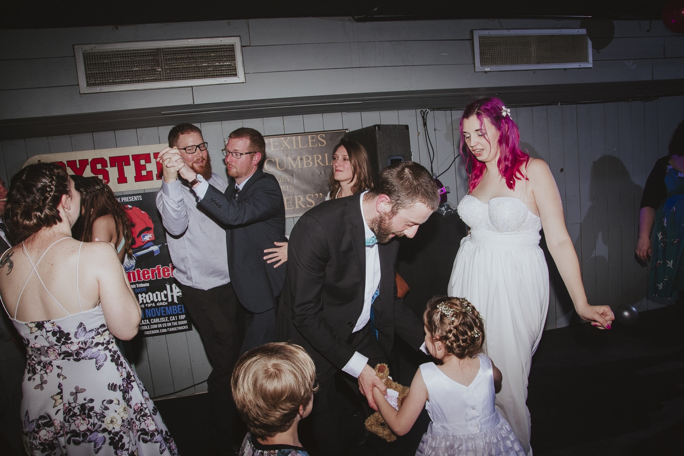 Bride and groom dancing at wedding by Joshua Wyborn Photographic