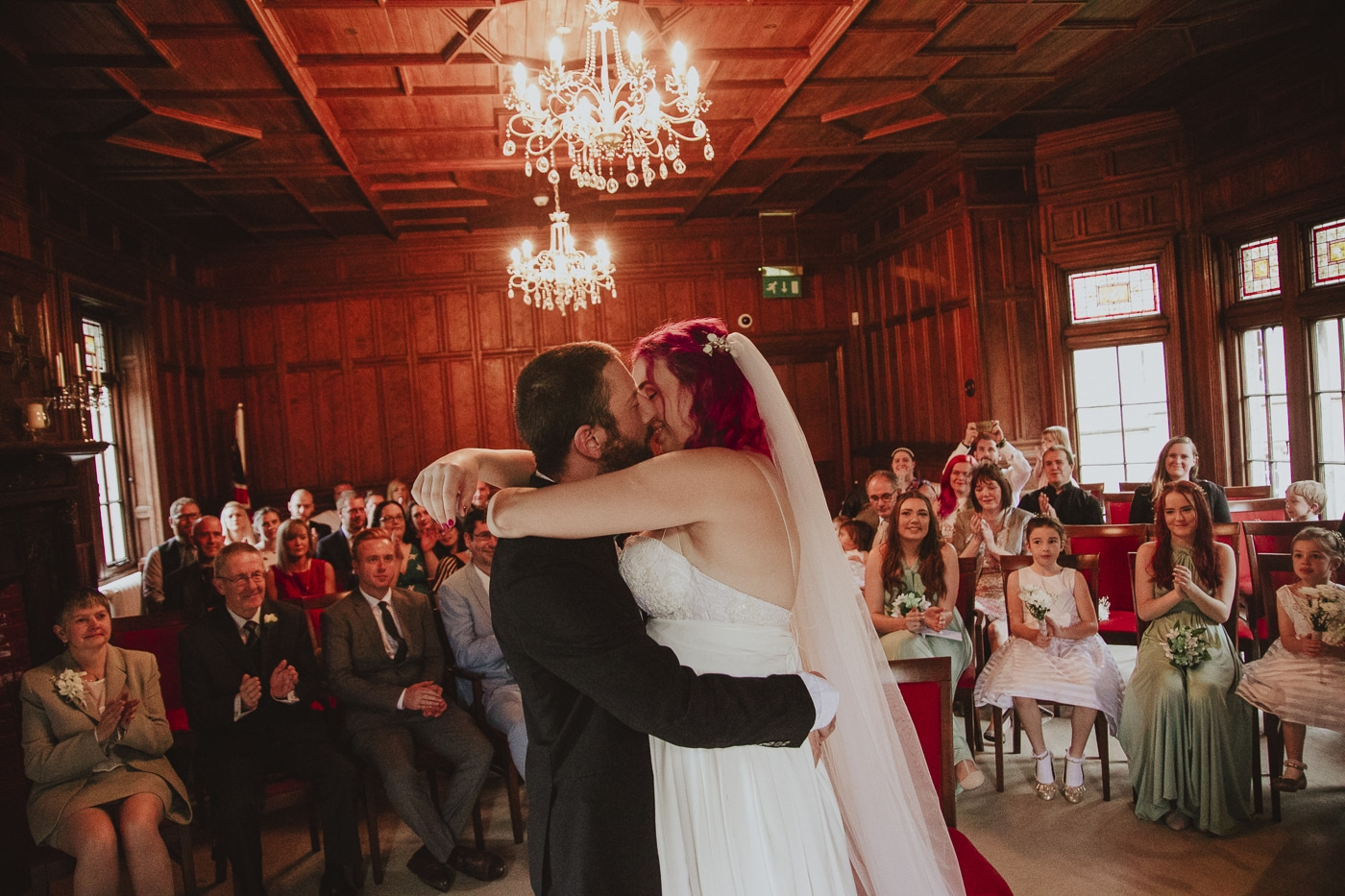 Alternative wedding bride and groom kissing by Joshua Wyborn