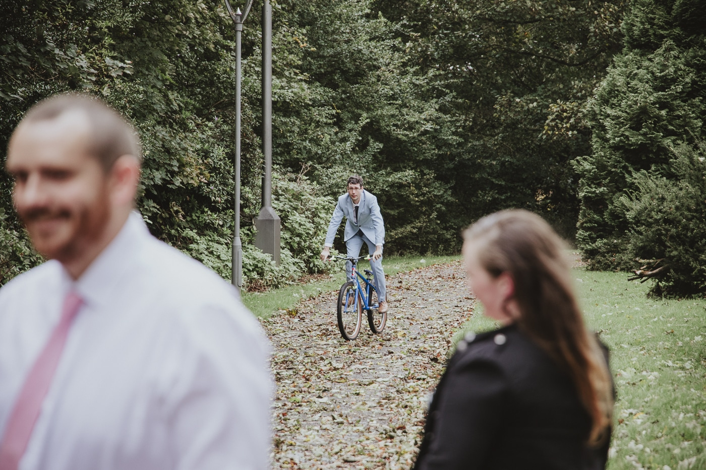 Best Man on bike at wedding by Joshua Wyborn