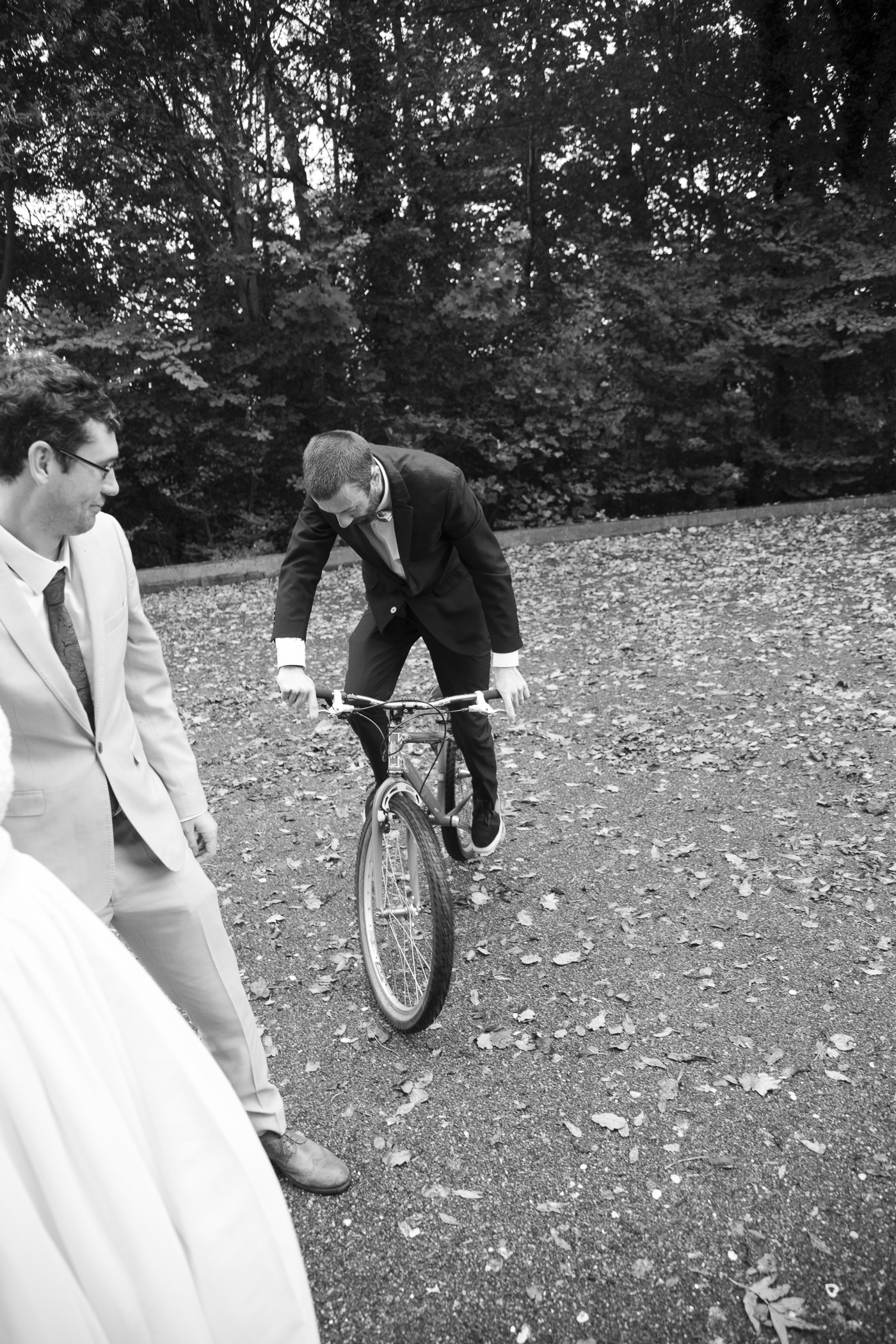Groom on bike by Joshua Wyborn