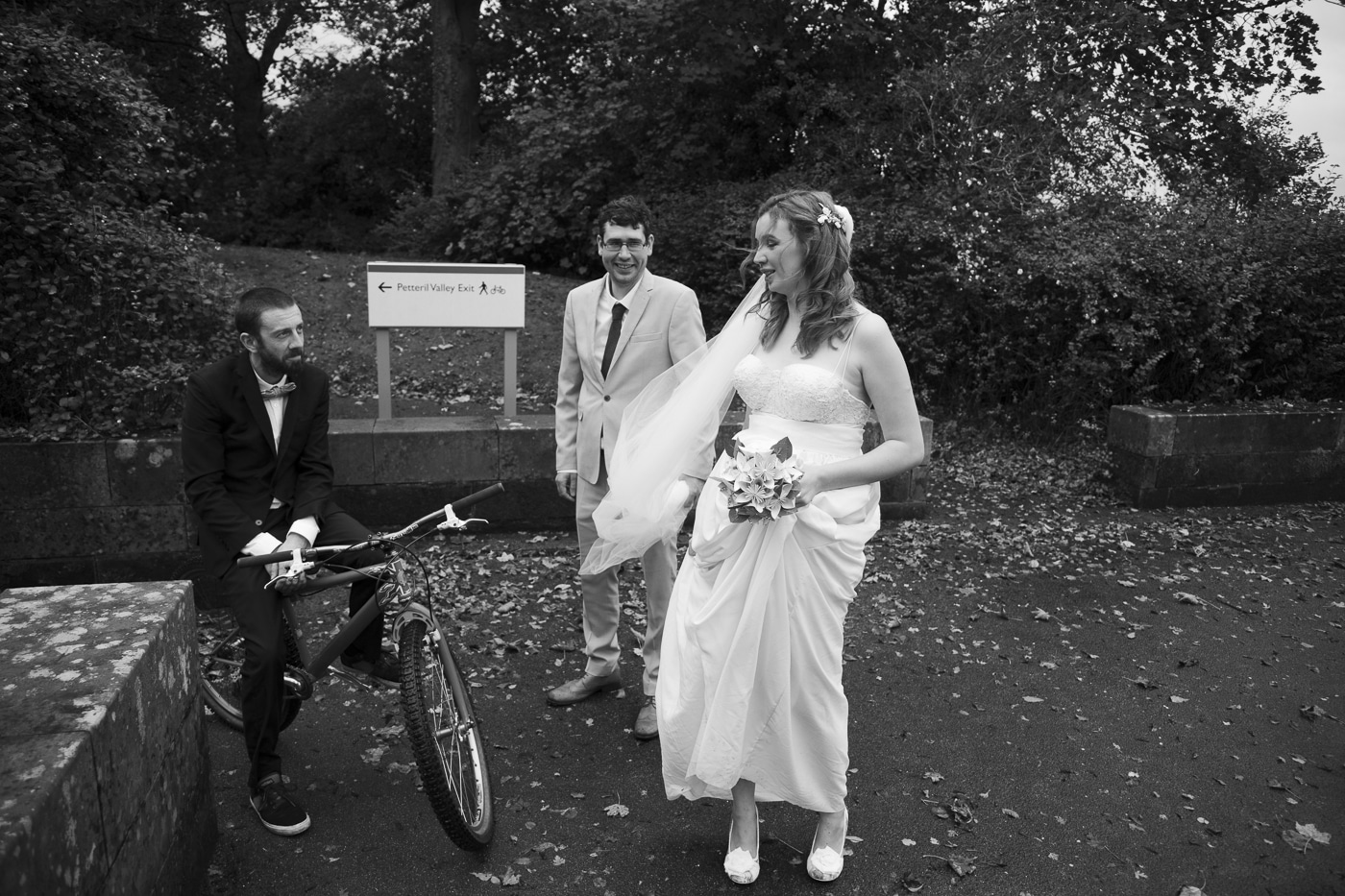 Bride and groom on bike by Joshua Wyborn