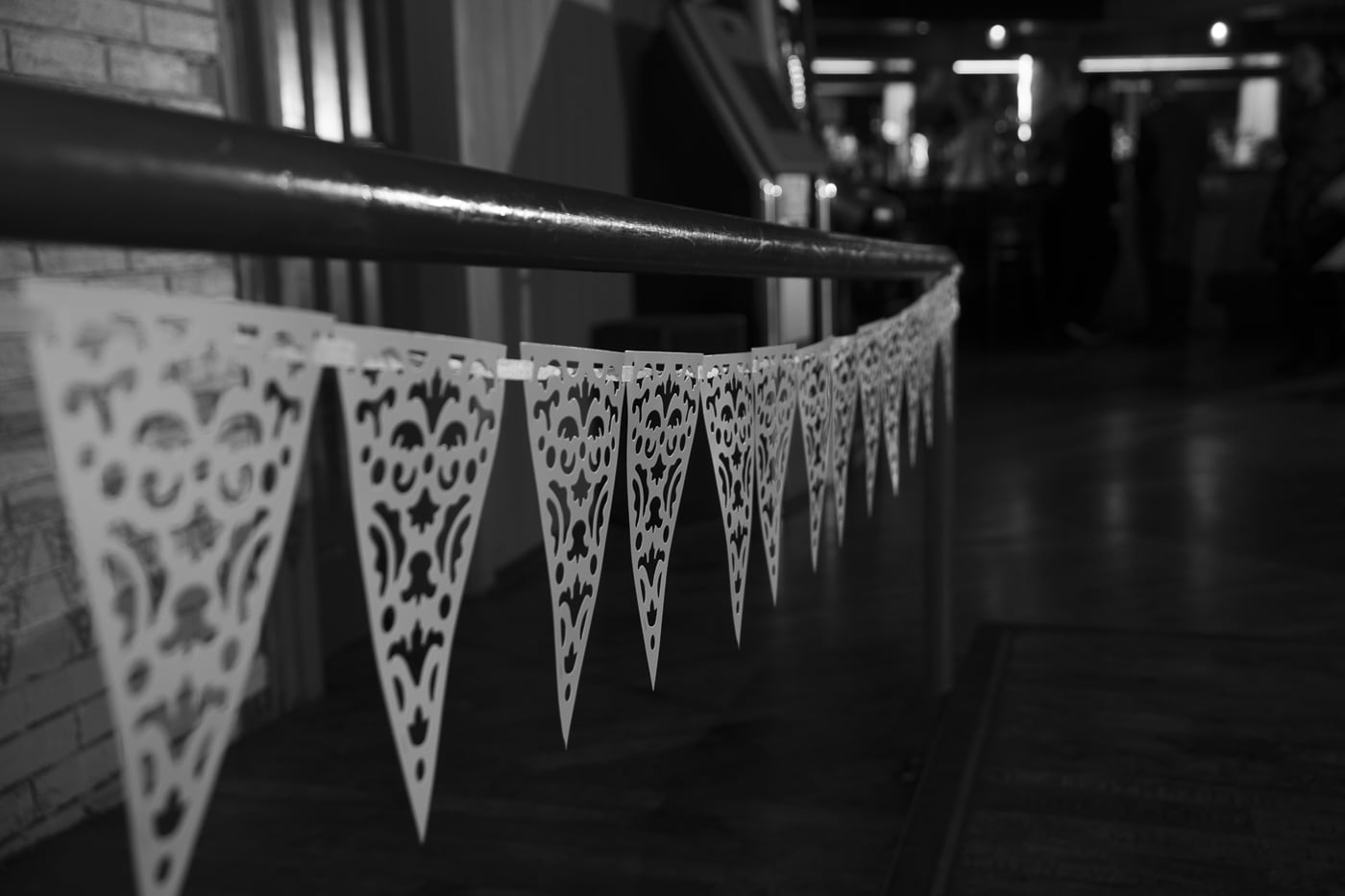 Wedding bunting along railing by Joshua Wyborn