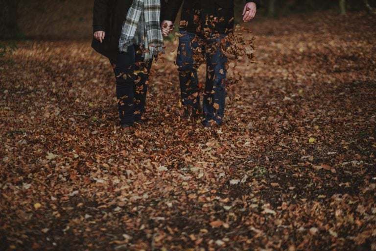 Kicking golden brown leaves on the floor by Joshua Wyborn