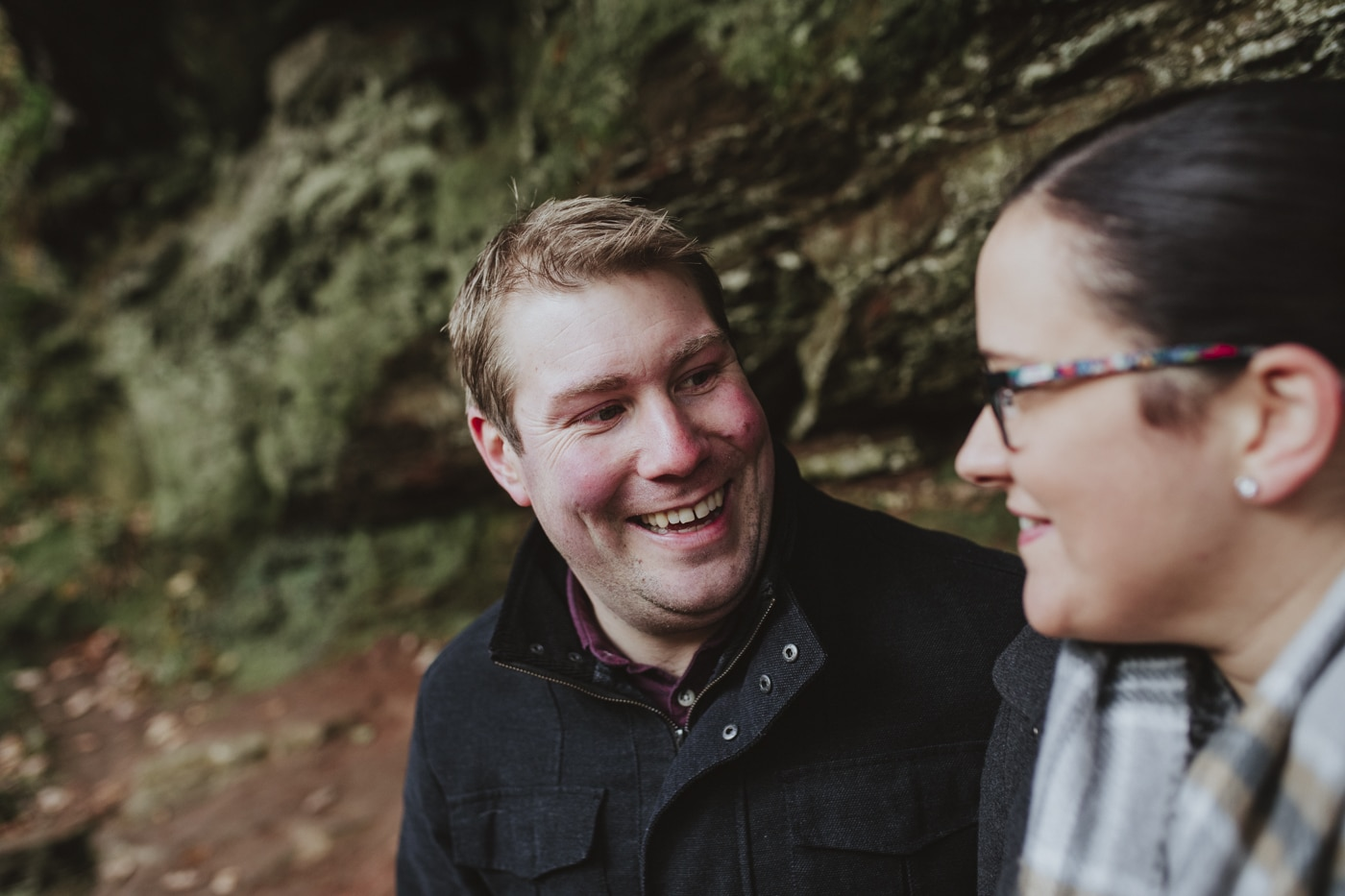 Laughing man during couple shoot in cumbria by Joshua Wyborn