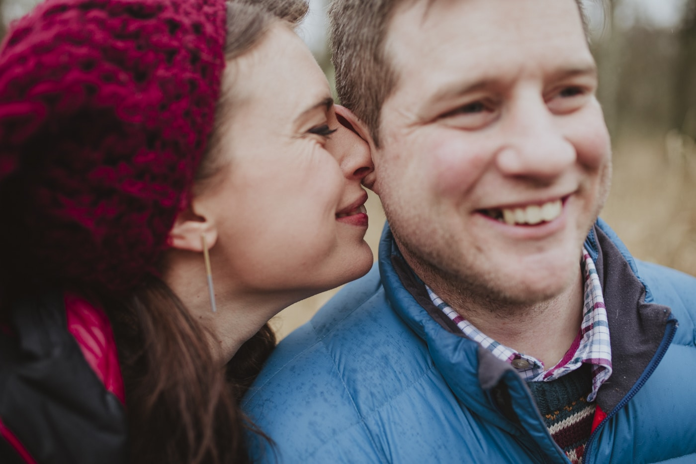 Woman whispering in mans ear for Joshua Wyborn Photographic