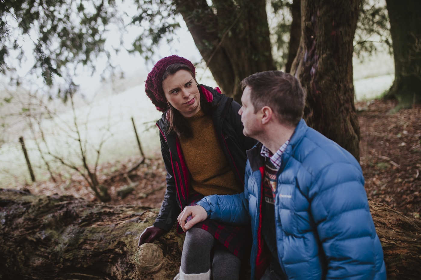 Couple making funny faces in the forest by Joshua Wyborn Photography