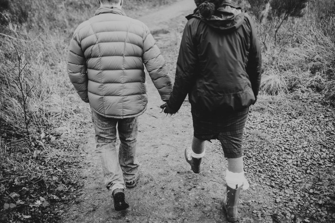Portrait session man and woman walking holding hands by Joshua Wyborn Photographic