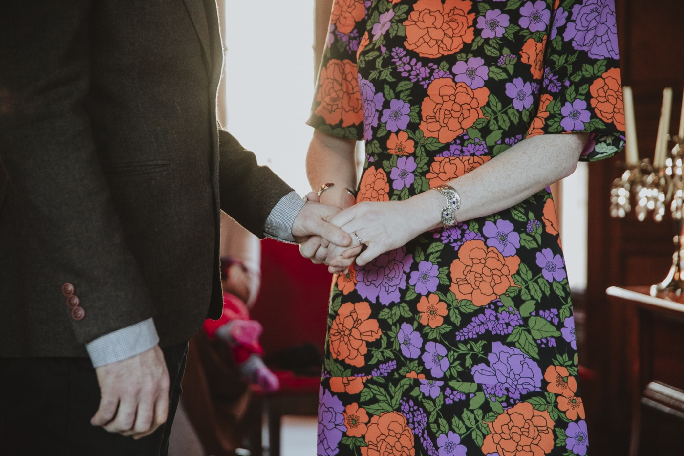 Holding hands during ceremony by Joshua Wyborn Photographic