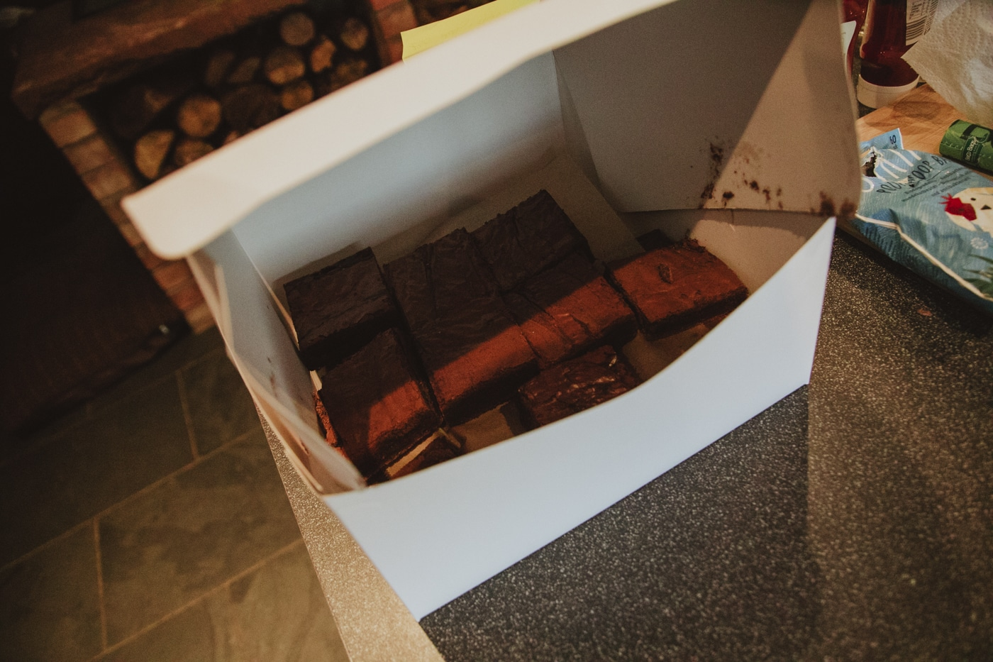 Box of chocolate brownies by Joshua Wyborn