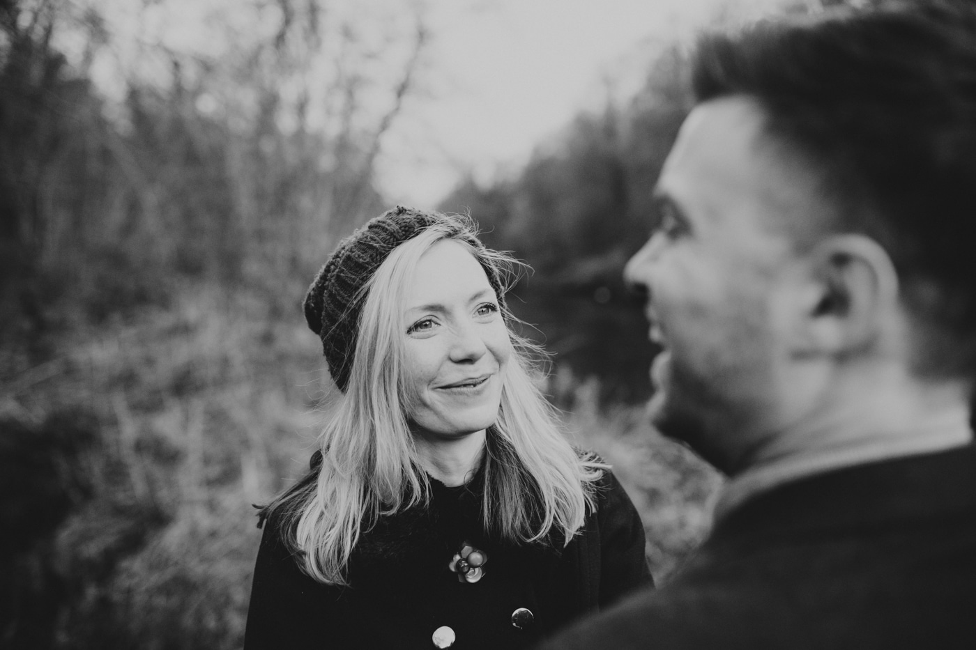 Wife looking at laughing husband by Joshua Wyborn Photographic